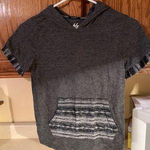 Short sleeve shirt with hood.